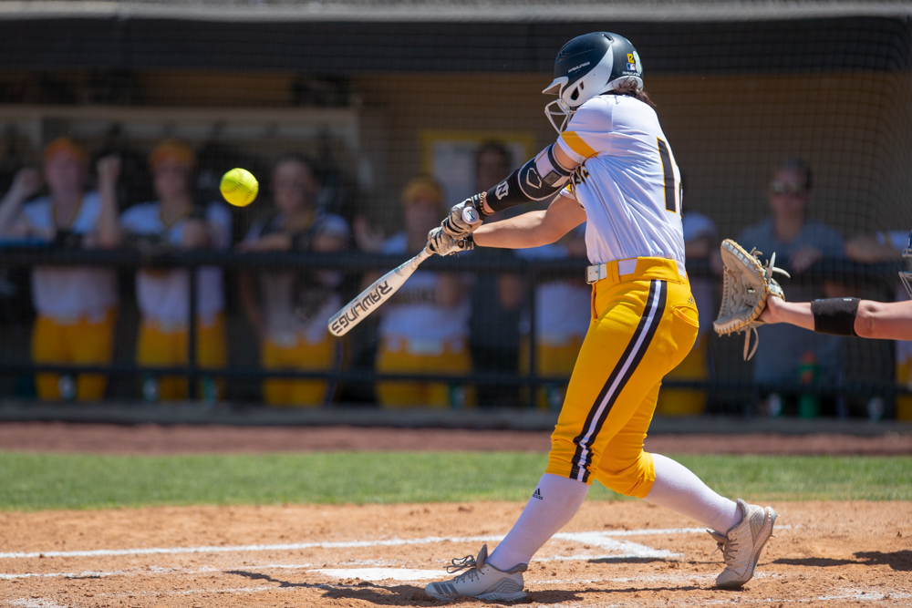 Wichita+State+freshman+Adi+Reese+makes+contact+during+the+game+against+Tulsa+on+April+27%2C+2019+at+Collins+Family+Softball+Complex+in+Tulsa%2C+Oklahoma.+%28Photo+by+Joseph+Barringhaus%2FThe+Sunflower%29.