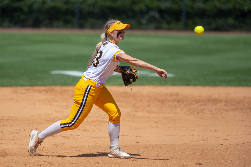 Wichita+State+junior+Ryleigh+Buck+makes+a+throw+to+first+for+an+out+during+the+game+against+Tulsa+on+April+27%2C+2019+at+Collins+Family+Softball+Complex+in+Tulsa%2C+Oklahoma.+%28Photo+by+Joseph+Barringhaus%2FThe+Sunflower%29.