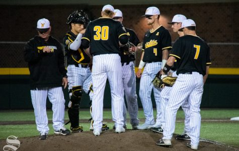 Wichita State infielders meet during a time out in the sixth inning of their game against University of Houston. (Photo by Easton Thompson/The Sunflower).