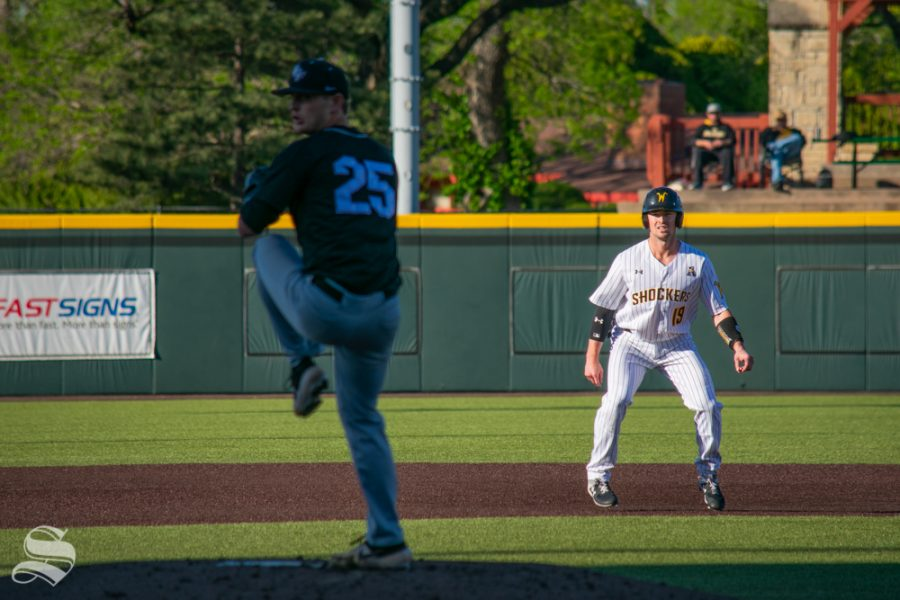 Wichita+State%27s+Luke+Ritter+leads+off+of+second+base+while+University+of+Florida%27s+Chris+Williams+winds+up+for+a+pitch+during+their+game+at+Tyler+Field.+