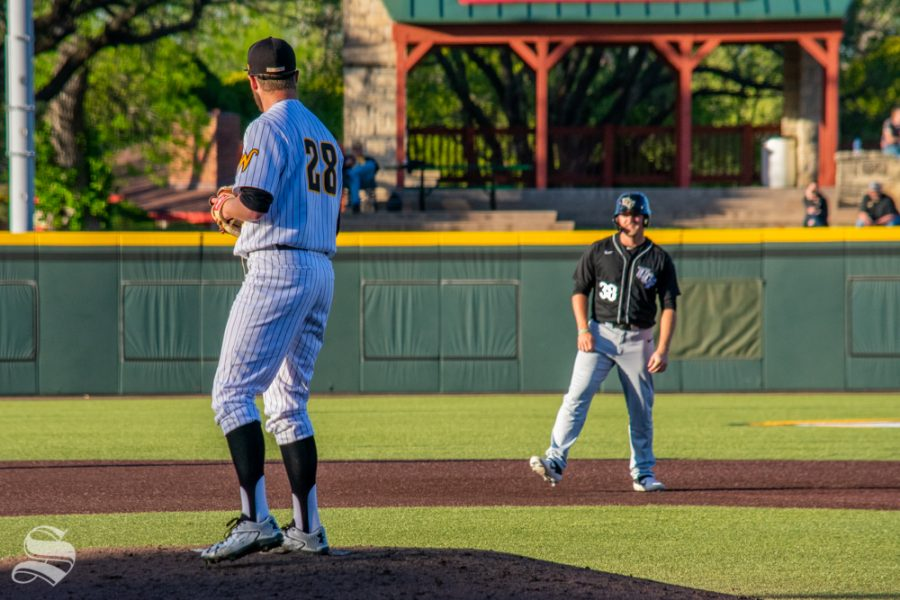 Wichita+State%27s+Preston+Snavely+watches+University+of+Central+Florida%27s+Dallas+Beaver+take+his+lead+off+of+second+base+during+their+game+at+Tyler+Field.+%28Photos+by+Easton+Thompson+%2F+The+Sunflower%29.