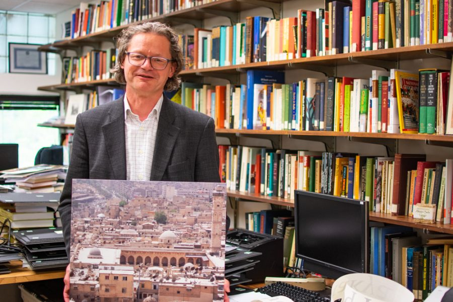 Dr. Jens Kreinath shows one of his photos from a day trip to Aleppo in Syria on May 29, 2010. The photos will soon be on display in Neff Hall.