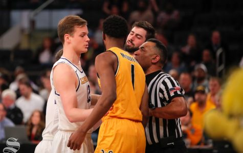 Wichita State senior Markis McDuffie exchanges words with Lipscomb forward Matt Rose during the second half of the game on April 2, 2019 at Madison Square Garden in New York. (Photo by Joseph Barringhaus/The Sunflower).