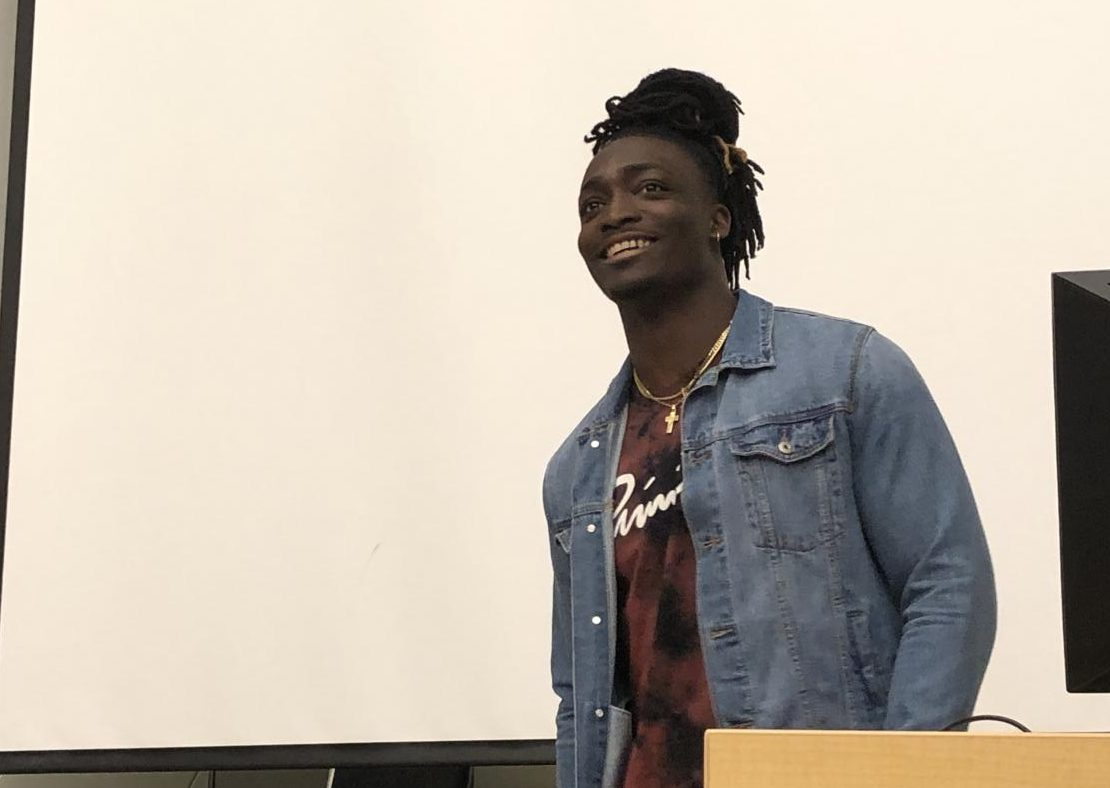 Wichita native Davontae Harris speaks during a Black Student Union meeting Thursday. Harris was drafted by the Cincinnati Bengals in 2018.