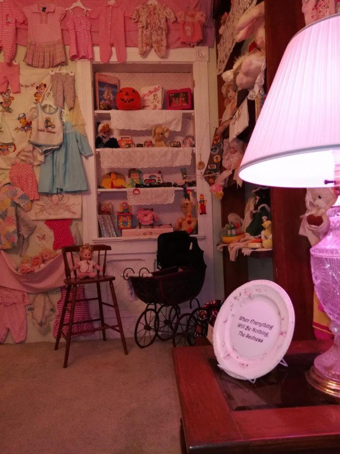 The Monikahouse library acts as a physical catalog of items and clothing that artist Monika Maddux had saved to give to her daughter.