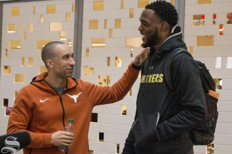 Texas Head Coach Shaka Smart greets Wichita State senior Markis McDuffie at the Marriott Marquis in New York on April 1, 2019.