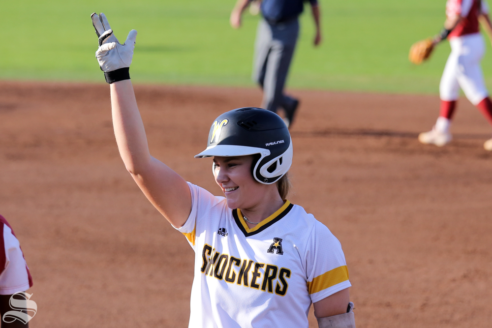 Wichita+State%27s+Wylie+Glover+celebrates+after+grounding+a+single+past+the+first+baseman.+No.+1+Oklahoma+defeated+Wichita+State+8-0+in+five+innings+on+April+24+at+Wilkins+Stadium.+%28Photo+by+Evan+Pflugradt%2FThe+Sunflower%29.