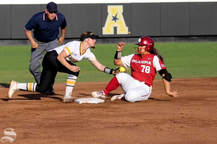 Wichita State's Sydney McKinney fails to tag out an Oklahoma base runner. No. 1 Oklahoma defeated Wichita State 8-0 in five innings on April 24 at Wilkins Stadium. (Photo by Evan Pflugradt/The Sunflower).