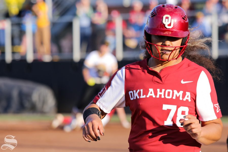 Oklahomas Jocelyn Alo returns to third base after a tag out at first base. No. 1 Oklahoma defeated Wichita State 8-0 in five innings on April 24 at Wilkins Stadium. (Photo by Evan Pflugradt/The Sunflower).