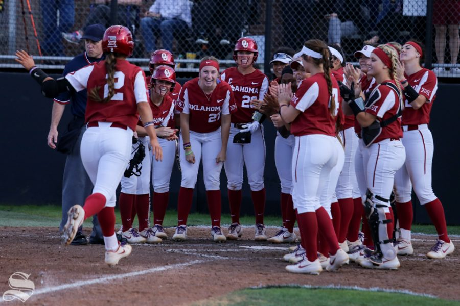 Oklahoma's Sydney Romero celebrates a home run with her teammates. No. 1 Oklahoma defeated Wichita State 8-0 in five innings on April 24 at Wilkins Stadium. (Photo by Evan Pflugradt/The Sunflower).