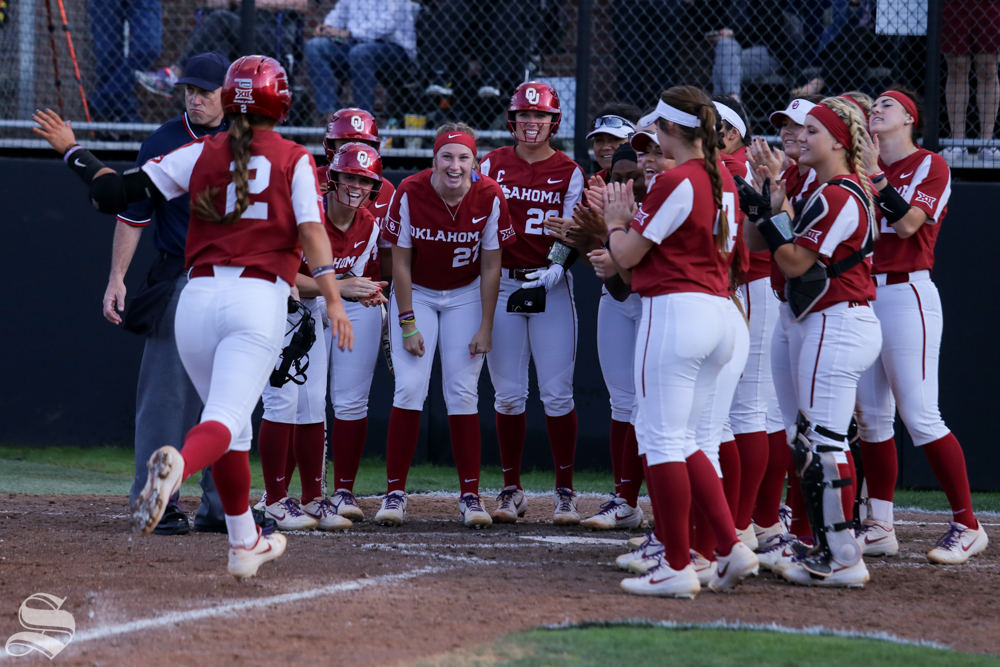 Oklahoma%27s+Sydney+Romero+celebrates+a+home+run+with+her+teammates.+No.+1+Oklahoma+defeated+Wichita+State+8-0+in+five+innings+on+April+24+at+Wilkins+Stadium.+%28Photo+by+Evan+Pflugradt%2FThe+Sunflower%29.