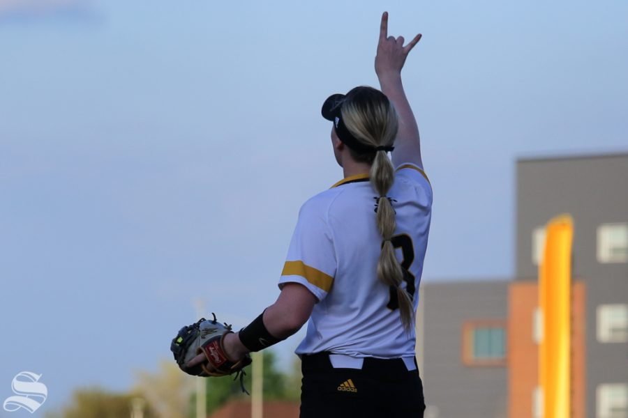 Wichita State's Caitlyn Bingham signals the outfield. No. 1 Oklahoma defeated Wichita State 8-0 in five innings on April 24 at Wilkins Stadium. (Photo by Evan Pflugradt/The Sunflower).