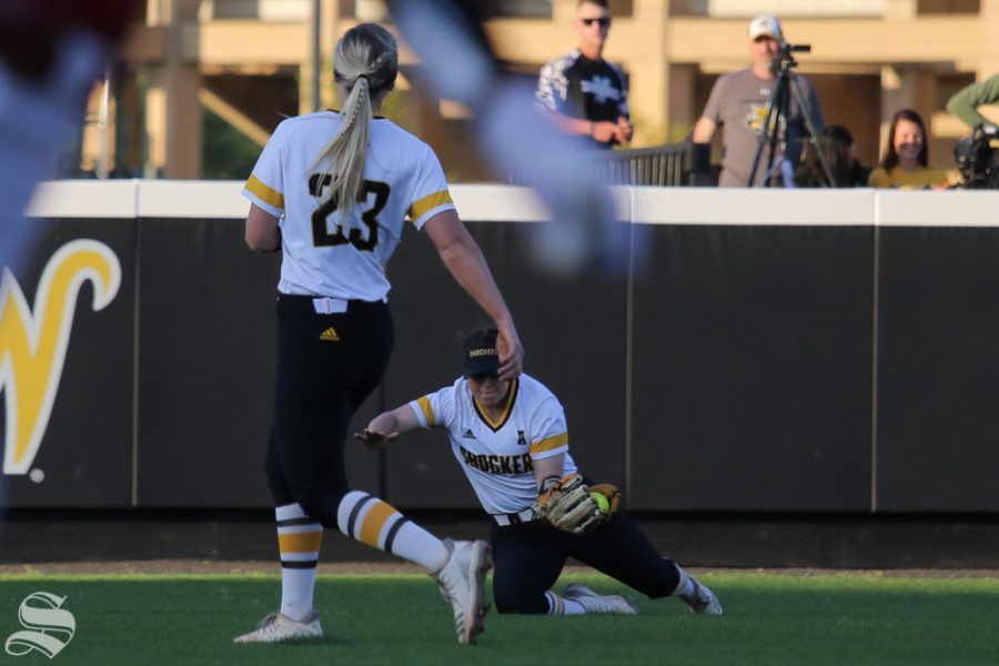 Wichita State's Wylie Glover fields a pop-out to center field. She completed the diving catch. No. 1 Oklahoma defeated Wichita State 8-0 in five innings on April 24 at Wilkins Stadium. (Photo by Evan Pflugradt/The Sunflower).