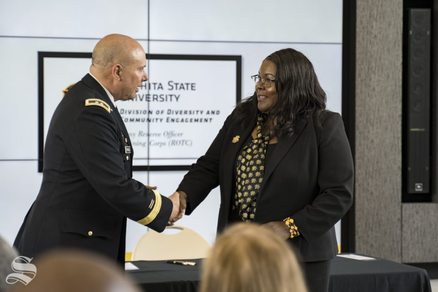 Vice+President+of+Diversity+and+Community+Engagement+Marche+Fleming-Randle+shakes+hands+with+Major+General+Lee+Tafanelli+of+the+Kansas+Army+National+Guard.+Fleming-Randle+was+instrumental+in+making+the+ROTC+program+happen%2C+Tafanelli+said.