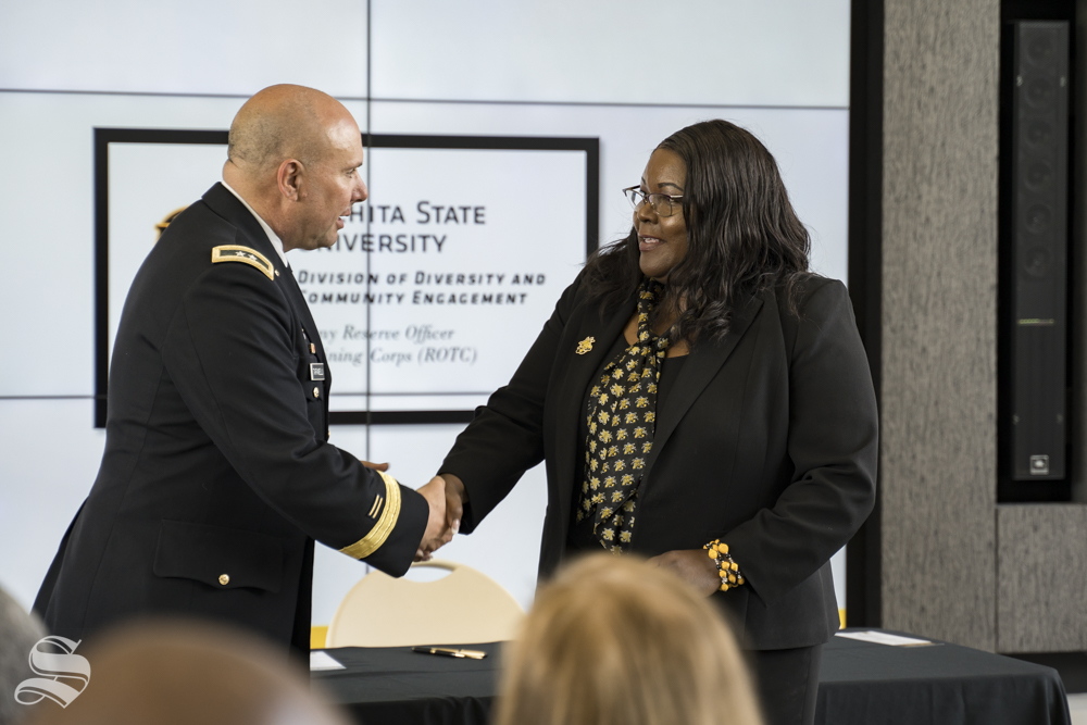 Vice President of Diversity and Community Engagement Marche Fleming-Randle shakes hands with Major General Lee Tafanelli of the Kansas Army National Guard. Fleming-Randle was instrumental in making the ROTC program happen, Tafanelli said.