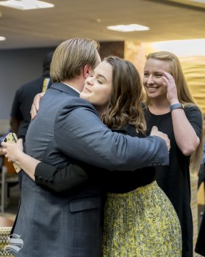 Michael Bearth hugs outgoing Student Body President Shelby Rowell after being elected student body vice president.