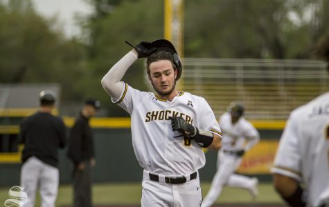Wichita State freshman Jack Sigrist jogs home after a home run during the game against OU on April 23, 2019 at Eck Stadium.