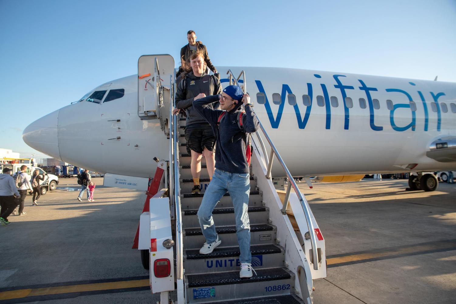 Evan Pflugradt walks off the plane in New York on the way to the NIT. (Photo by Joseph Barringhaus/The Sunflower).