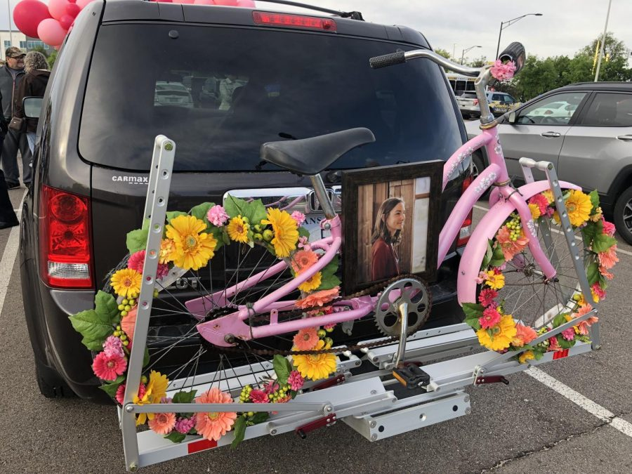 A decorated bike with a photo of Bridget Harrison is mounted to the back of a support vehicle that is following the cyclists to Canada. A gifted surgeon who suffered from anorexia, Bridget died last May at age 34.