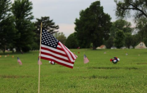 Small American flags were placed at two cemeteries in Derby, Kansas in preparation for Memorial Day events. Student Body Vice President Michael Bearth assisted veterans organizations in placing them.