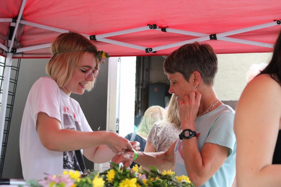 Kristyn Chapman of Cartwheel attached a wristband to a supporter at Jenny Woodstock on Saturday, May 25 at The Back Beat.