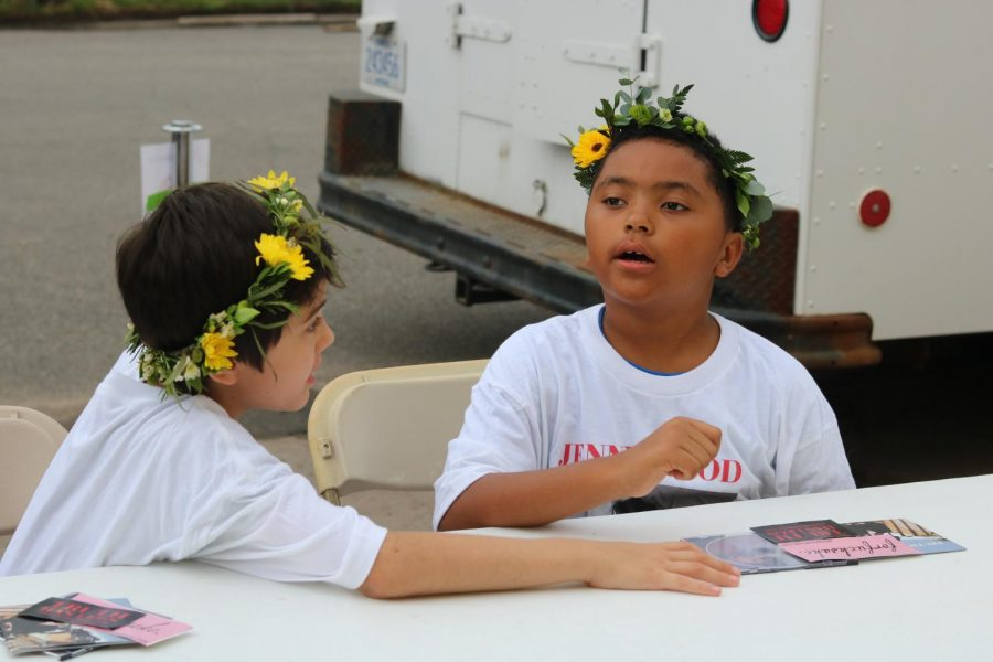 Sporting flower crowns and Jenny Wood shirts, two young boys show their support at Jenny Woodstock on Saturday, May 25 at The Back Beat.