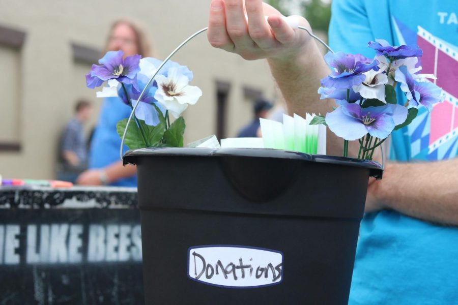 Volunteers held donation buckets adorned with flowers at Jenny Woodstock on Saturday, May 25 at The Back Beat.