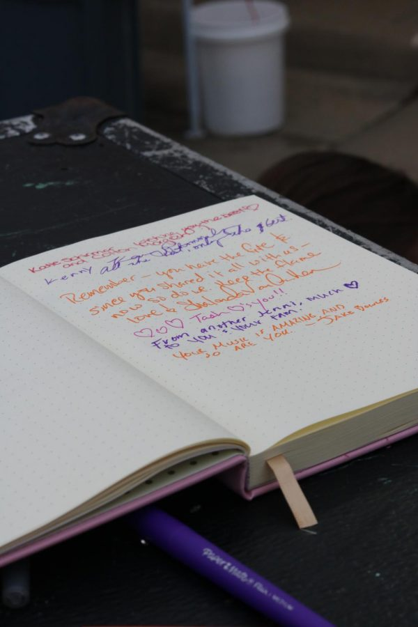 Friends, family, and supporters left encouraging notes for Jenny Wood in a notebook at Jenny Woodstock on Saturday, May 25 at The Back Beat.