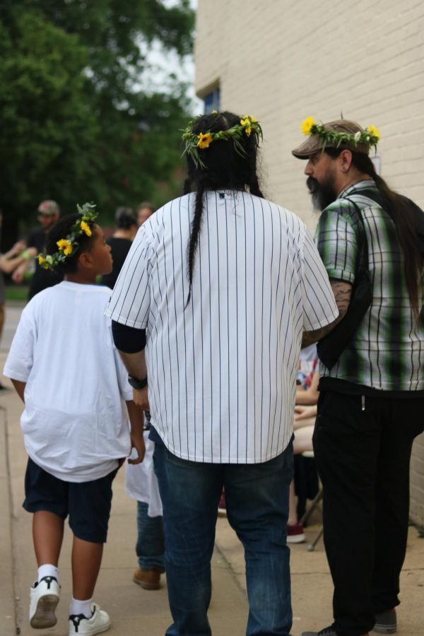 In full support of Jenny Woods recovery, men sport flower crowns donated by Beards Floral Design at Jenny Woodstock on Saturday, May 25 at The Back Beat.