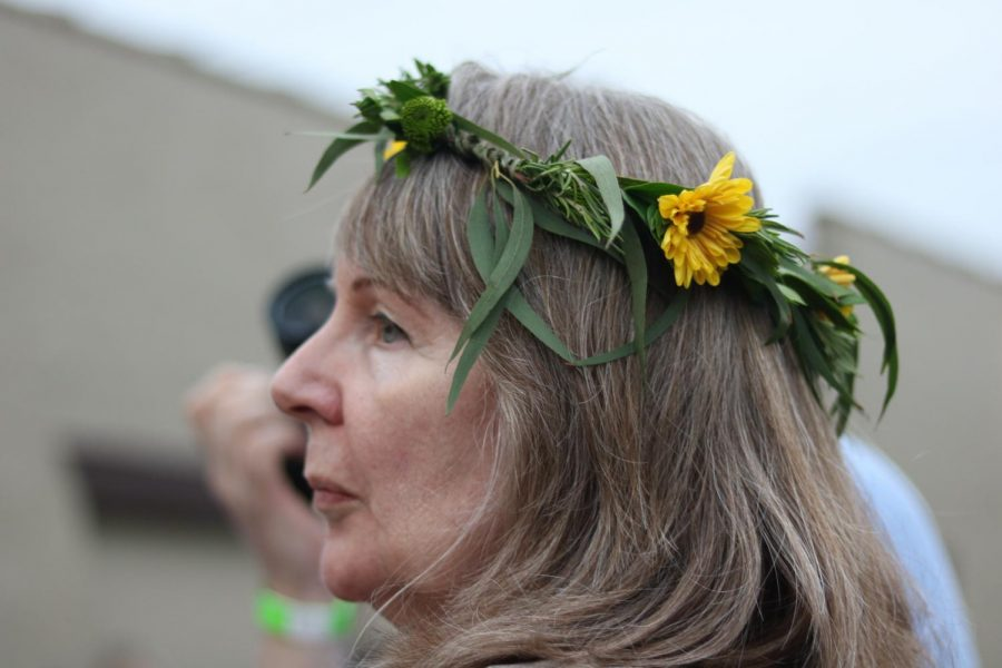 Wearing a flower crown donated by Beards Floral Design, a supporter watches musicians perform at Jenny Woodstock on Saturday, May 25 at The Back Beat.