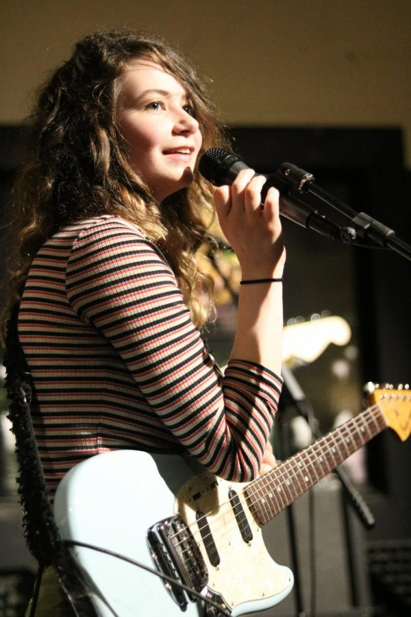 Sophie Emerson of The Cavves encourages the audience to donate at Jenny Woodstock on Saturday, May 25 at The Back Beat.