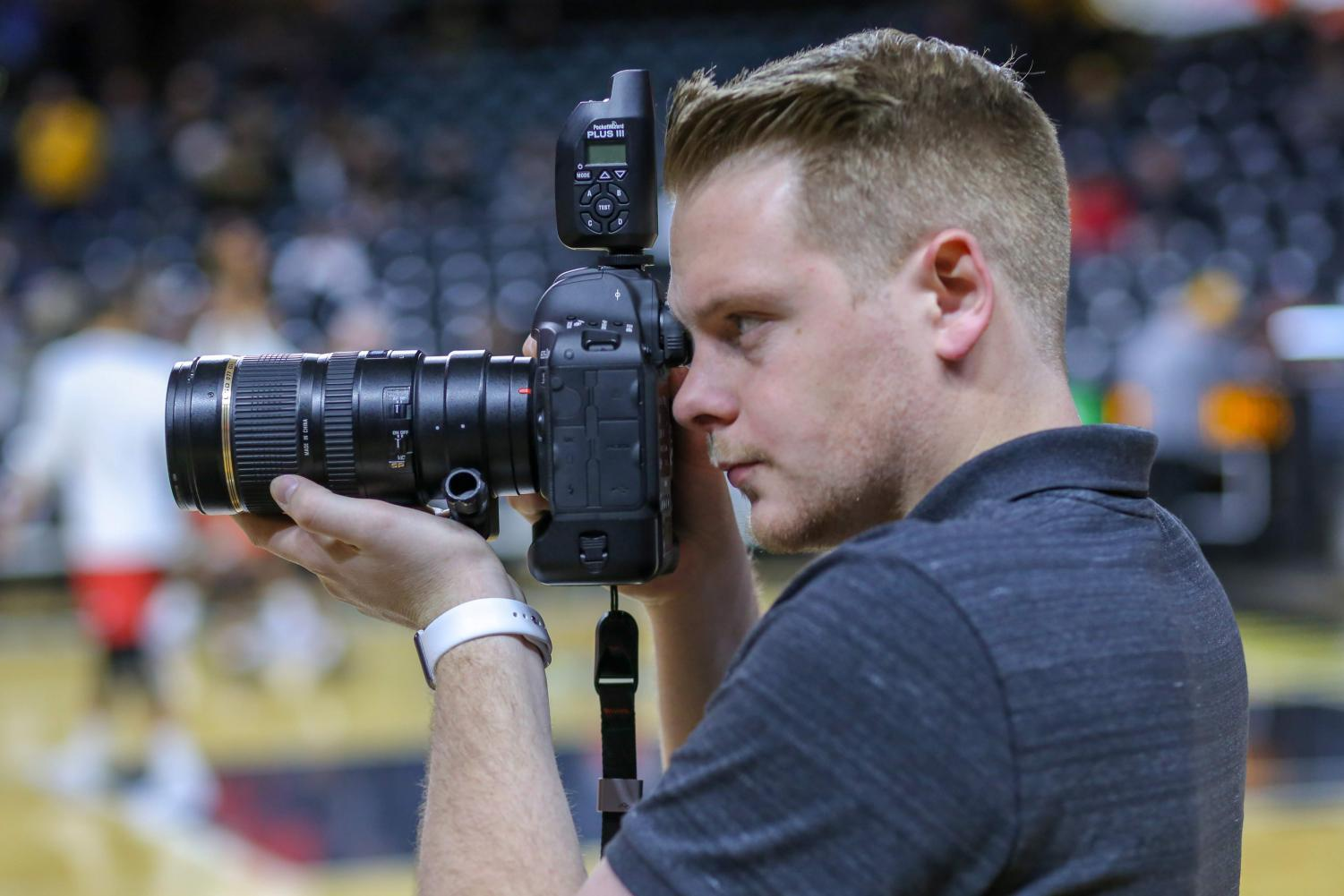Joseph Barringhaus takes a photo for The Sunflower during warm ups before a Wichita State mens basketball game.