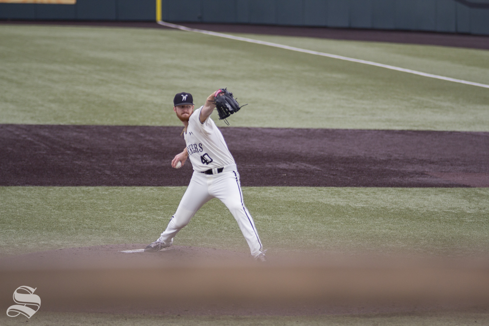 Wichita State senior Clayton McGinness pitches during the game against ECU on May 11, 2019 at Eck Stadium.