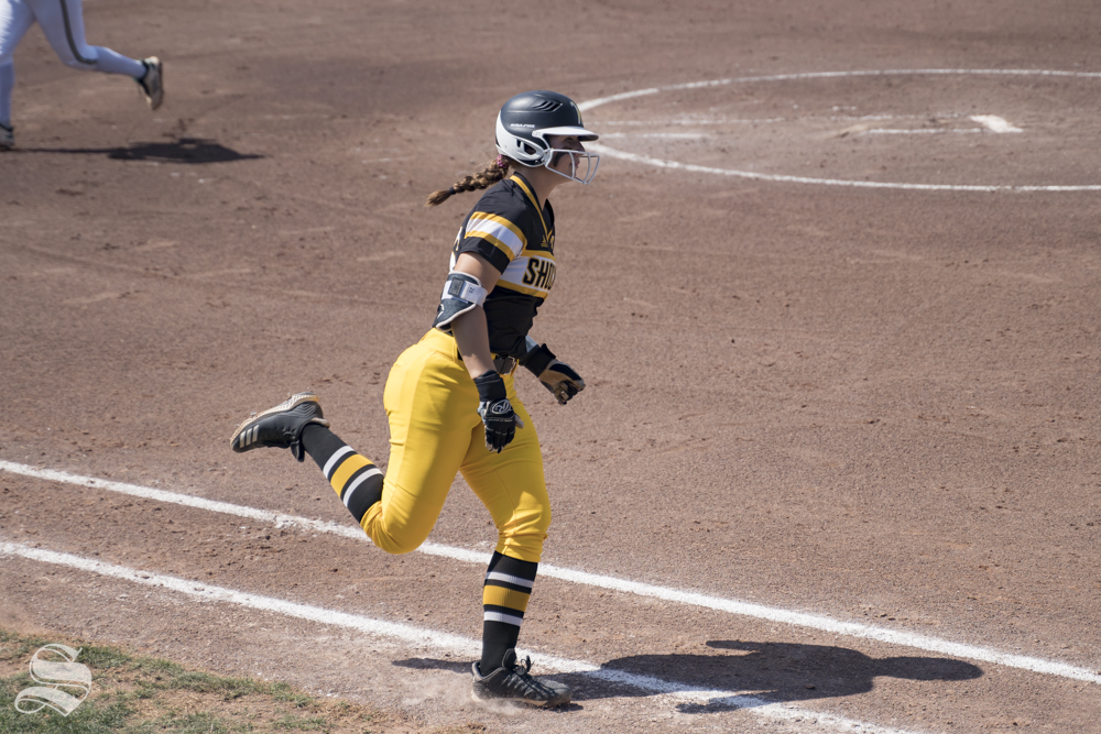 Wichita State freshman Sydney Mckinney runs to first base during the game against USF at Wilkins Stadium on May 4, 2019.