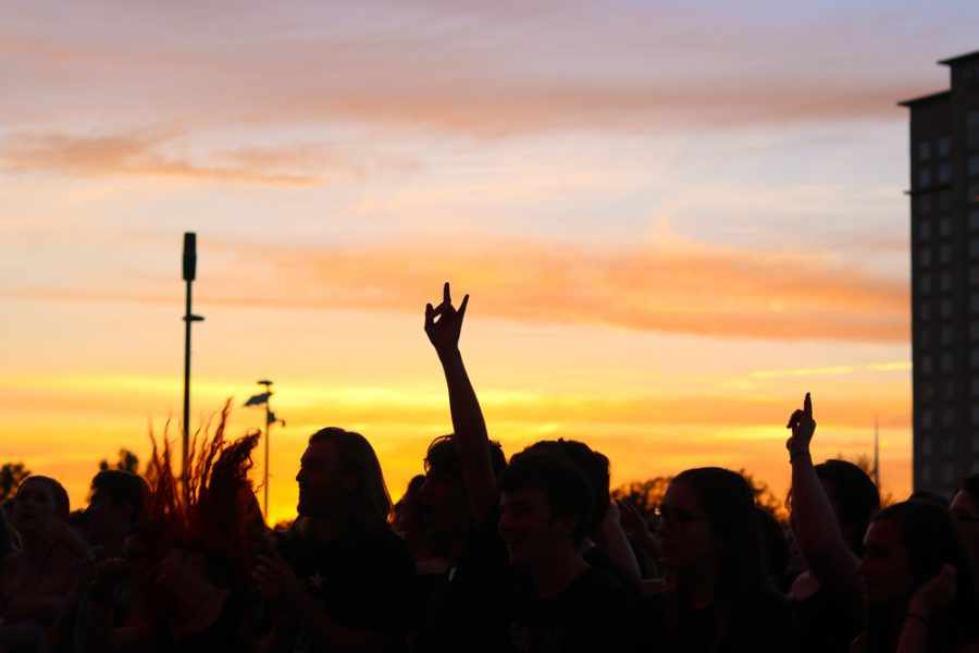 Fans rock out during The Cavvves golden hour performance at Riverfest on Thursday, June 6.