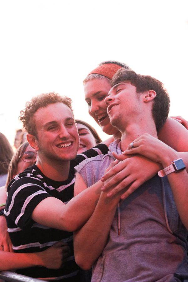Fans hug as The Cavves perform Soil Mates at Riverfest on Thursday, June 6.