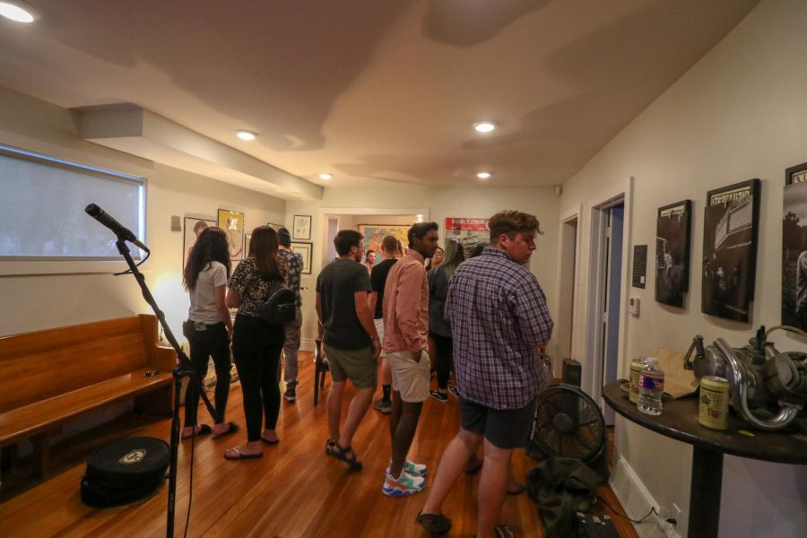 A+crowd+gathers+at+Ellis+Street+Moto+during+Final+Friday+before+local+acts+performed+at+the+gallery.