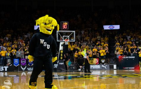 WuShock walks the court during a timeout in the game between the Aftershocks and Sideline Cancer as part of the Wichita Regional TBT tournament on July 27, 2019 in Charles Koch Arena.