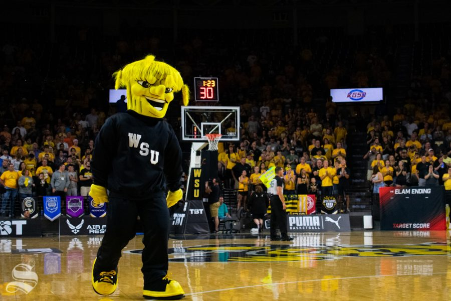 WuShock+walks+the+court+during+a+timeout+in+the+game+between+the+Aftershocks+and+Sideline+Cancer+as+part+of+the+Wichita+Regional+TBT+tournament+on+July+27%2C+2019+in+Charles+Koch+Arena.