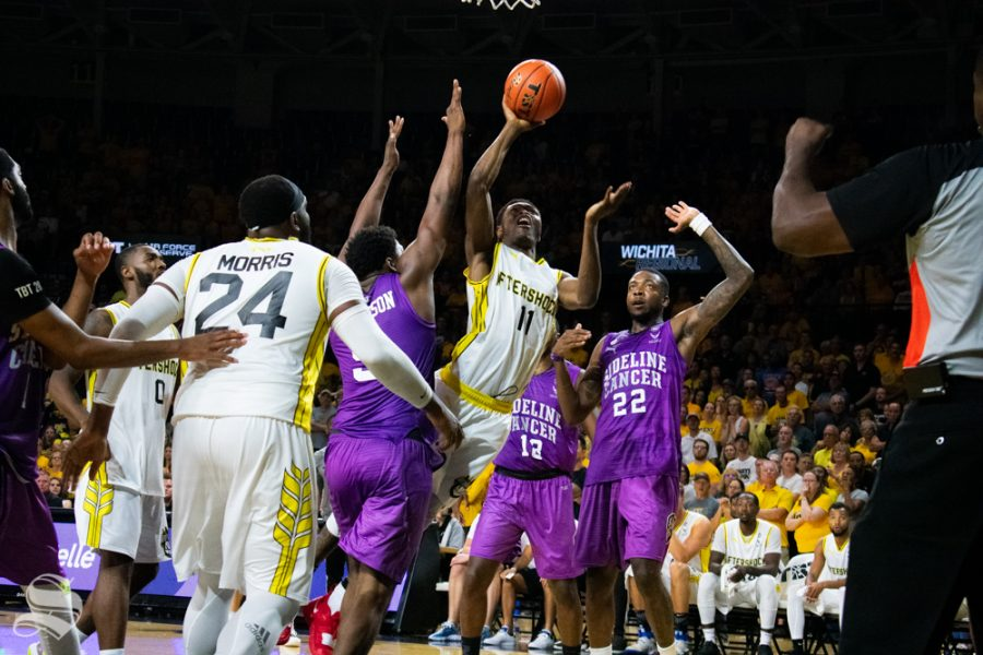 Aftershocks' Cleanthony Early jumps for the basket during their game against Sideline Cancer in the TBT tournament hosted at Charles Koch Arena.