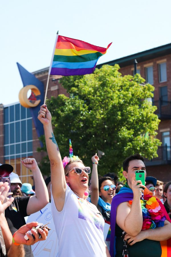 A+woman+wearing+a+unicorn+headband+holds+up+her+pride+flag+and+cheers+at+Wichita+Pride%27s+rally+on+Saturday%2C+June+29+in+Old+Town+Square.
