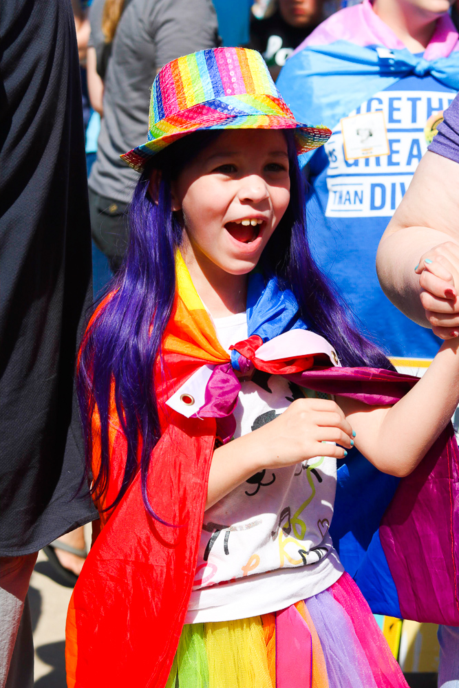 A+young+child+wears+a+pride+flag+during+Wichita+Pride%27s+rally+on+Saturday%2C+June+29+in+Old+Town+Square.