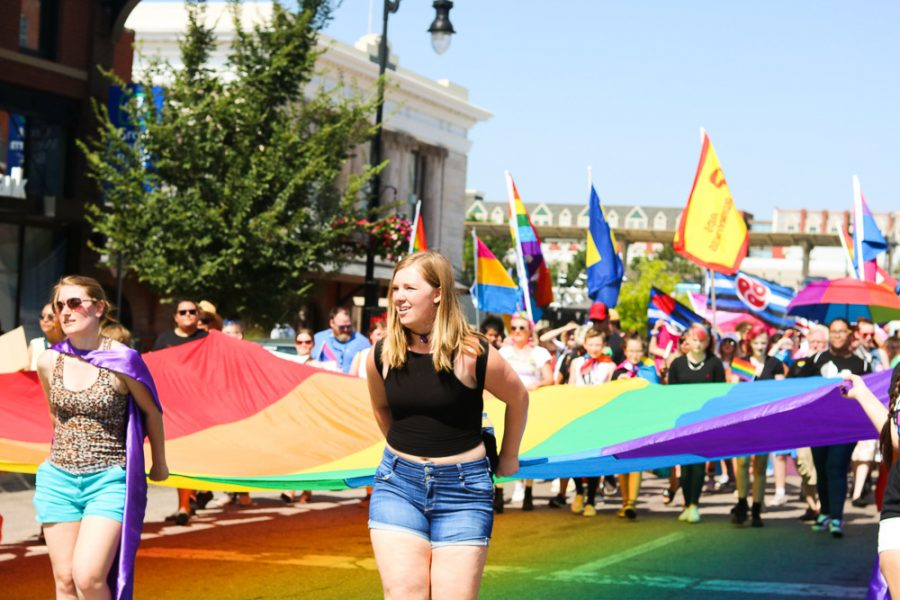 Marchers carry a giant pride flag through downtown Wichita during Wichita Pride's Unity March on Saturday, June 29.