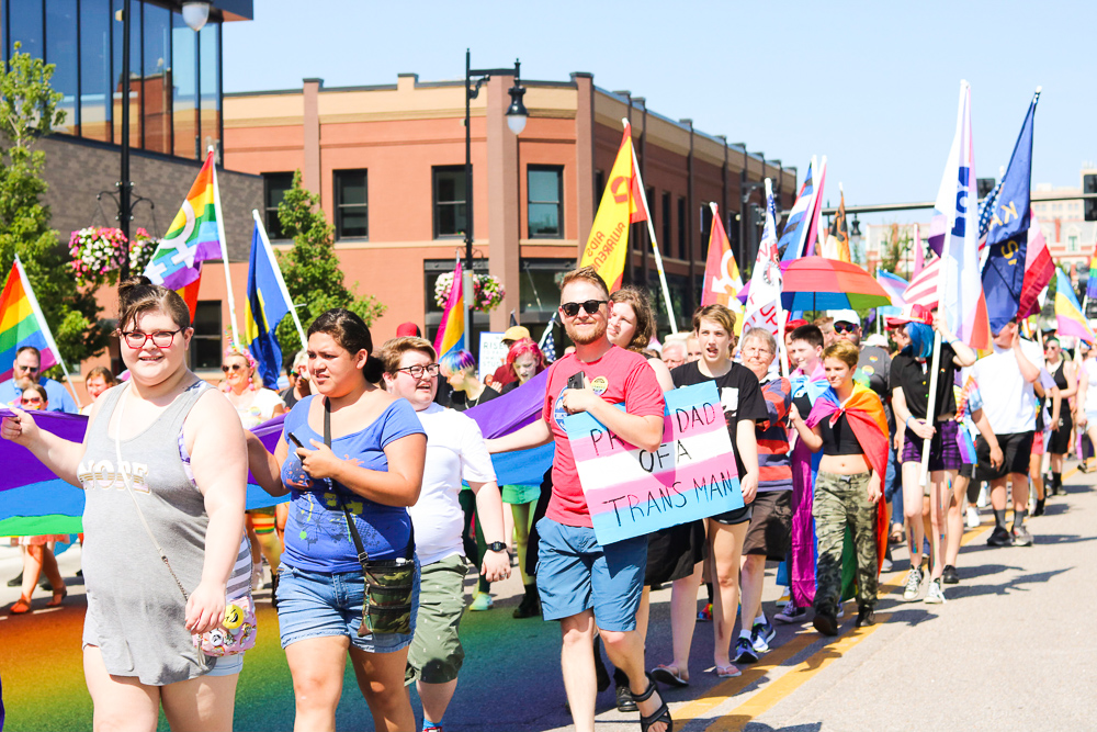 Marchers+carry+signs+and+flags+during+Wichita+Pride%27s+Unity+March+on+Saturday%2C+June+29.