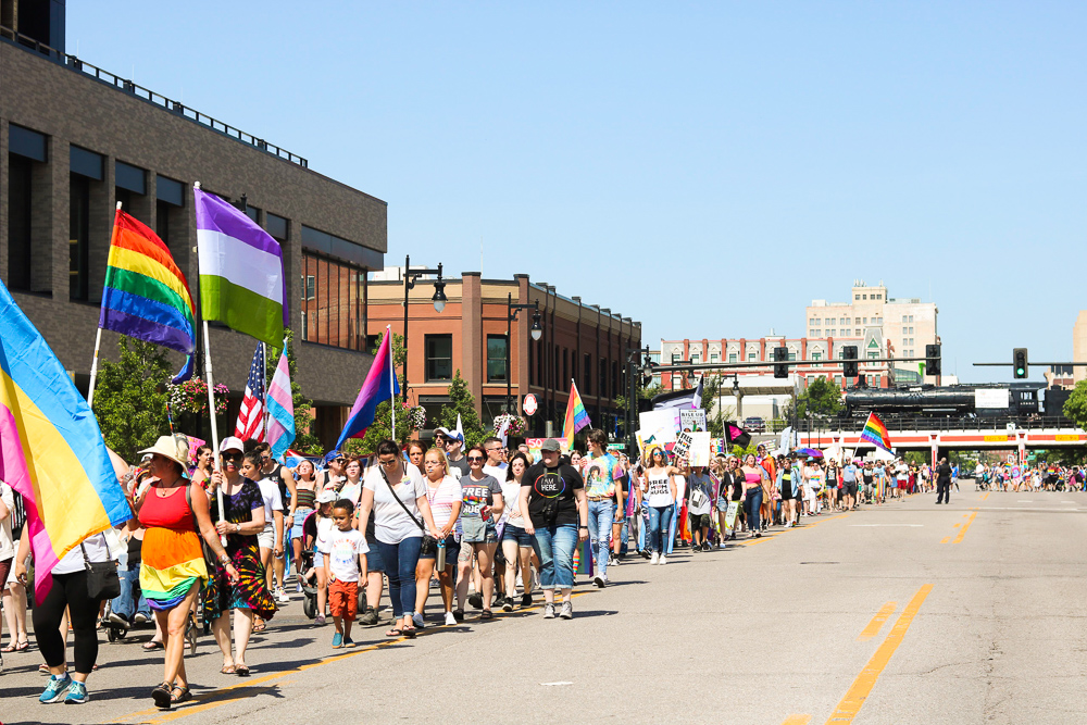 A+long+stream+of+marchers+taking+over+Douglas+during+Wichita+Pride%27s+Unity+March+on+Saturday%2C+June+29.