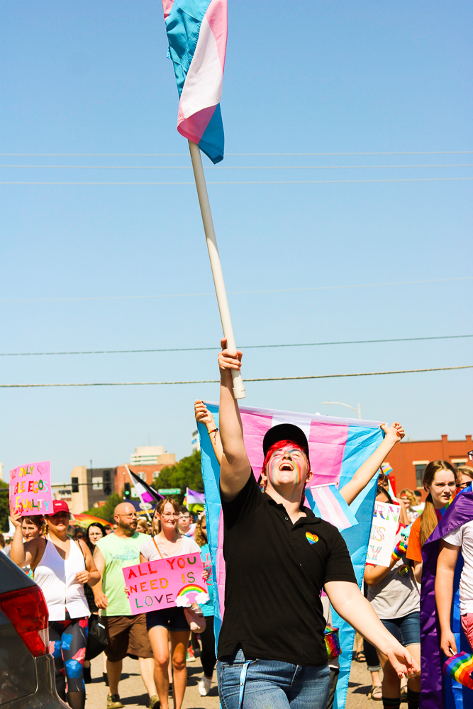 A+marcher+holds+up+a+transgender+pride+flag+during+Wichita+Pride%27s+Unity+March+on+Saturday%2C+June+29.