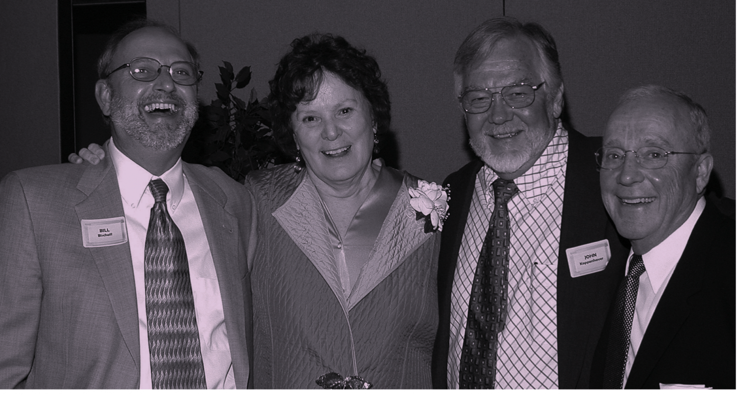 Carol Konek poses for a photo at her retirement dinner in 2005 with Bill Bischoff, John Koppenhaver and Paul Magelli. This photo originally appeared in the LAS Newsletter in fall 2005.