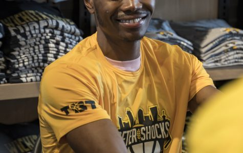 Former Shocker Cleanthony Early talks to a fan during an autograph signing. The event was held at the Braeburn Square Shocker Store on July 21, 2019.