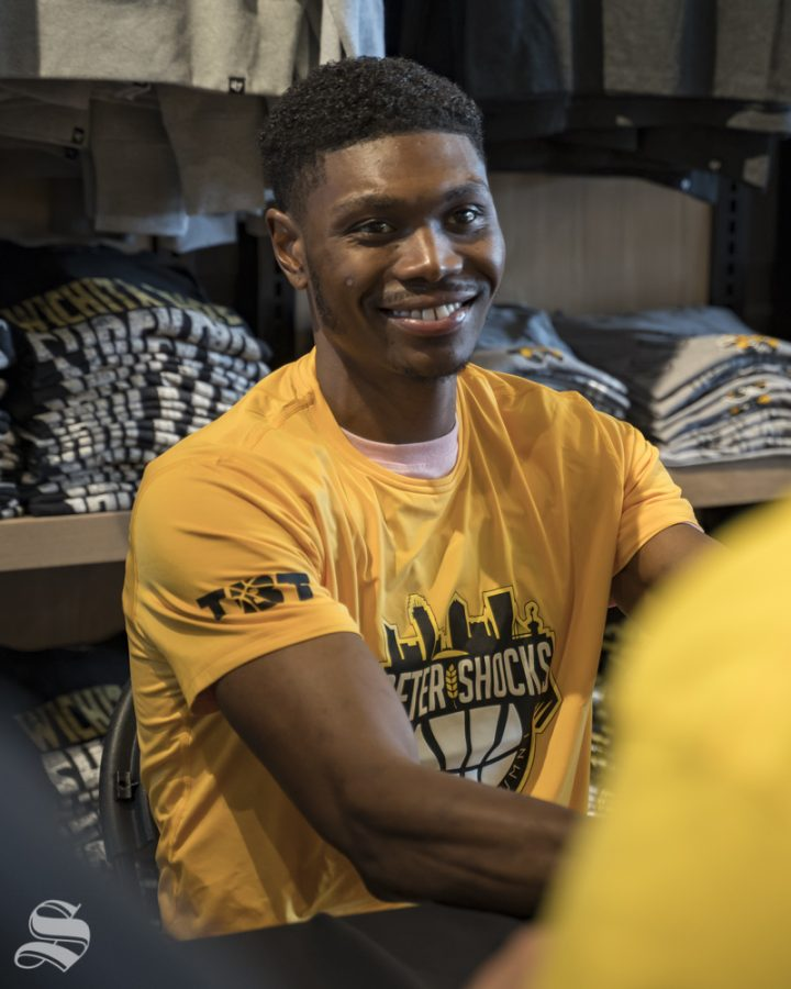 Former+Shocker+Cleanthony+Early+talks+to+a+fan+during+an+autograph+signing.+The+event+was+held+at+the+Braeburn+Square+Shocker+Store+on+July+21%2C+2019.