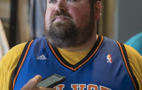 Russell Lowden had on a Toure Murry's signed Knicks jersey. Russell was among many other fans at Aftershocks's autograph signing event at Shocker Store on July 21, 2019.